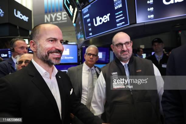 Uber CEO Dara Khosrowshahi walks the floor of the New York Stock Exchange after the Opening Bell at the NYSE as the ridehailing company Uber makes...