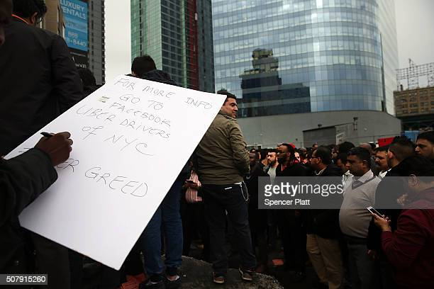 Uber drivers protest the company's recent fare cuts and go on strike in front of the car service's New York offices on February 1 2016 in New York...