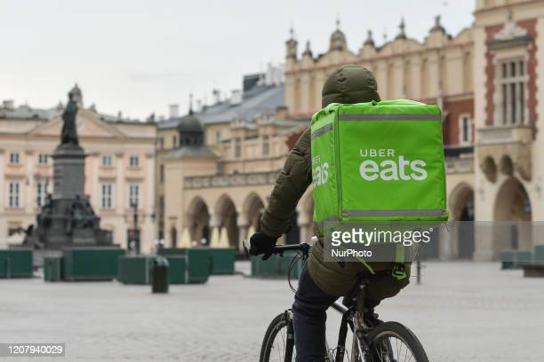 A Uber Eats currier seen in an empty Krakow's Market Square in Krakow on March 21 2020 Mateusz Morawiecki the Prime Minister of Poland announced...