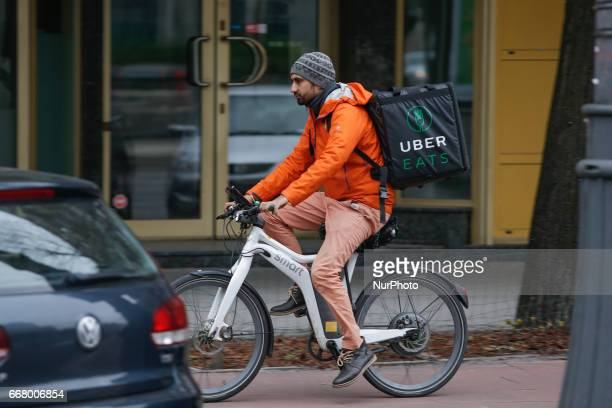A Uber EATS cyclist is seen in the center of Warsaw on 9 Aprl 2017