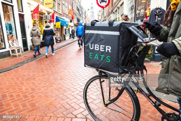 Uber Eats delivery man on a bicycle in Amsterdam