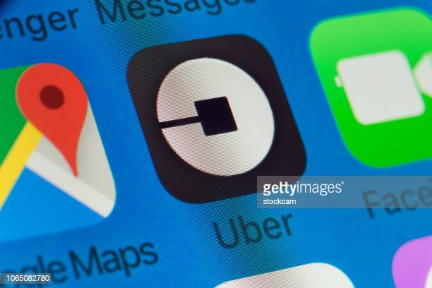 uber, facetime, google maps and other cellphone apps on iphone screen - uber brand name stock pictures, royalty-free photos & images