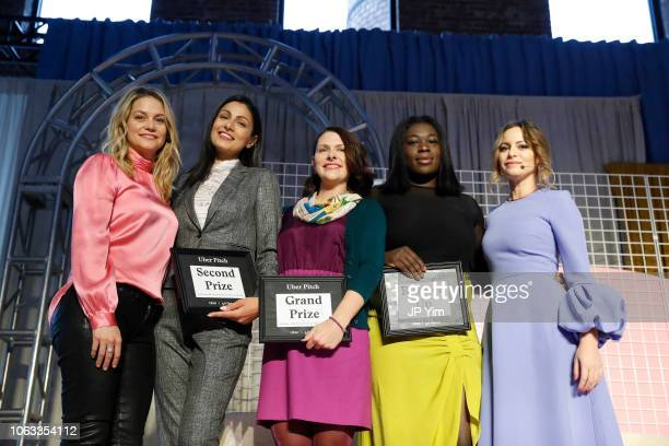 Uber Pitch finalists Erika Decker WykesSneyd Bilyana Freye Ashley LambSinclair Jamela Acheampong and Sophia Amoruso pose onstage at Girlboss Rally...