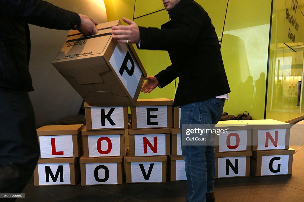 Uber staff prepare boxes of petitions before drivers posed for a photograph outside the Transport for London headquarters on December 22, 2015 in London, England. The Uber drivers formally handed in the petition, signed by over 205,000 people, to oppose proposals such as introducing minimum 5 minute waiting times.