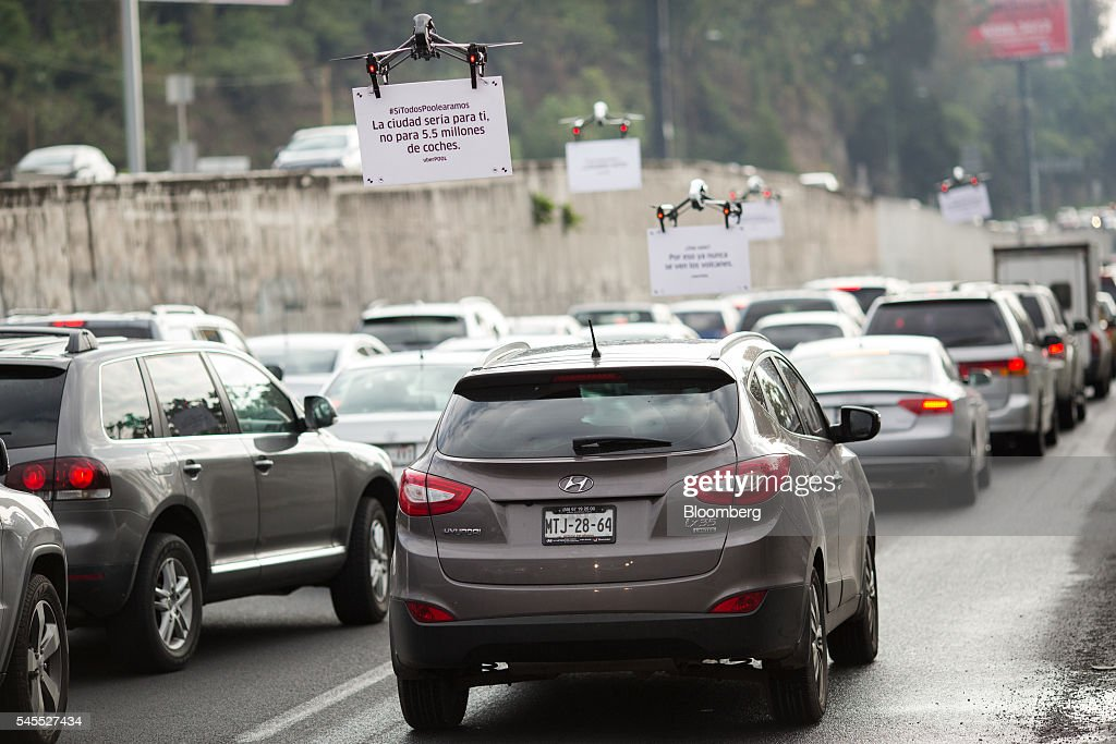 Uber Technologies Inc. drones advertise uberPOOL above traf : News Photo