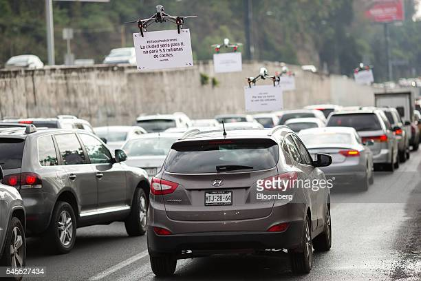 Uber Technologies Inc drones advertise uberPOOL above traffic on a highway in Mexico City Mexico on Friday June 17 2016 The air quality in Mexico...