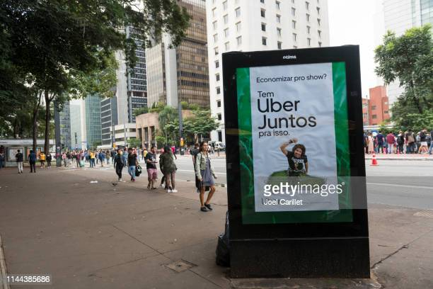 uber juntos advertisement in são paulo, brazil - sharing economy stock pictures, royalty-free photos & images