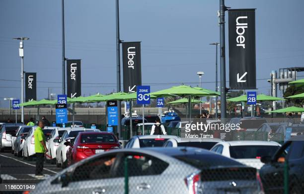 Uber vehicles are lined up at the new 'LAXit' ridehail passenger pickup lot at Los Angeles International Airport on November 6 2019 in Los Angeles...
