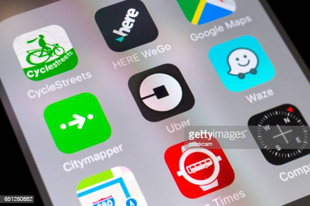 uber, waze, citymapper and other travel apps on cellphone - uber stock photos and pictures