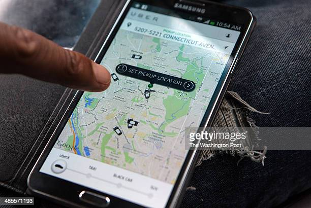 UberX driver Michael Belet checks the Uber customer app to see where other Uber drivers are working so he can determine where the best place for him...