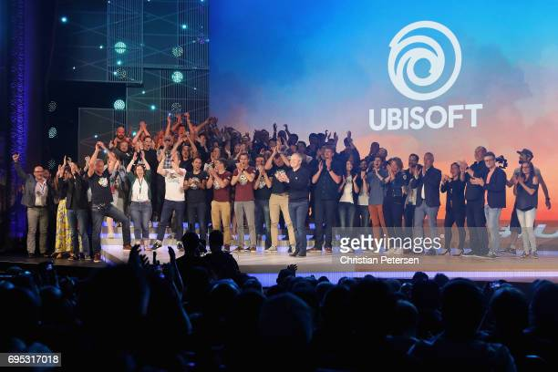 Ubisoft Co-founder and CEO Yves Guillemot poses with team Ubisoft onstage following the Ubisoft E3 conference at the Orpheum Theater on June 12, 2017...
