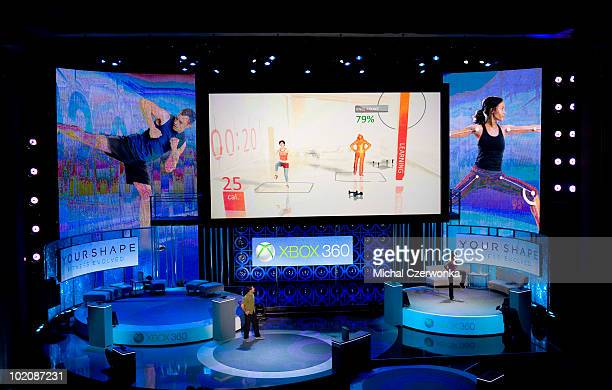 Ubisoft's Felicia Williams demonstrates a new fitness game that utilizes the Kinect peripheral for the new Xbox 360 console at a Microsoft press...