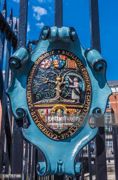 ublic of ireland, dublin, coat of arms on the gate of saint patrick's cathedral - anglican stock pictures, royalty-free photos & images