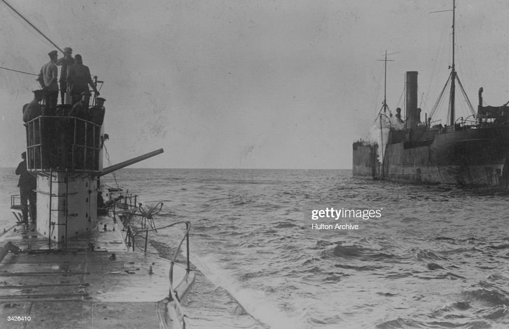A u-boat opens fire with a deck cannon, upon an allied merchant ship.