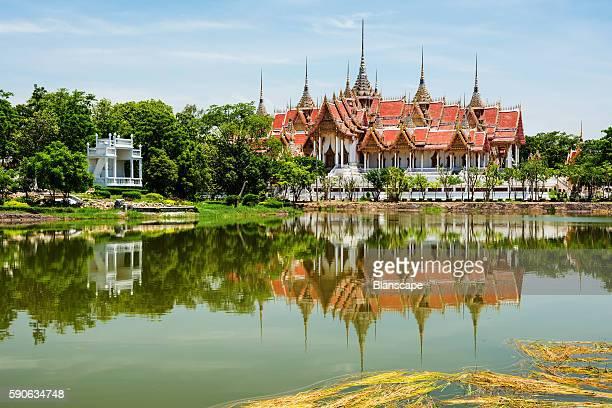 Ubosot Roi Yord with reflection at Wat Phai Rong Wua, Suphanburi