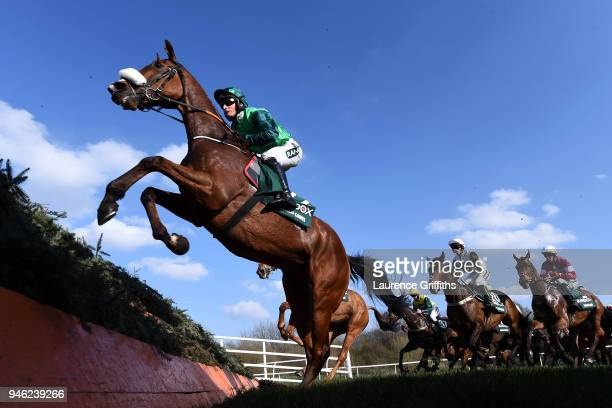 Ucello Conte ridden by Daryl Jacob jumps the Canl Turn during the 2018 Randox Health Grand National at Aintree Racecourse on April 14 2018 in...