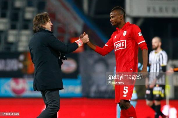 Uche Henry Agbo defender of Standard Liege Ricardo Sa Pinto head coach of Standard Liege during the Jupiler Pro League match between Charleroi and...