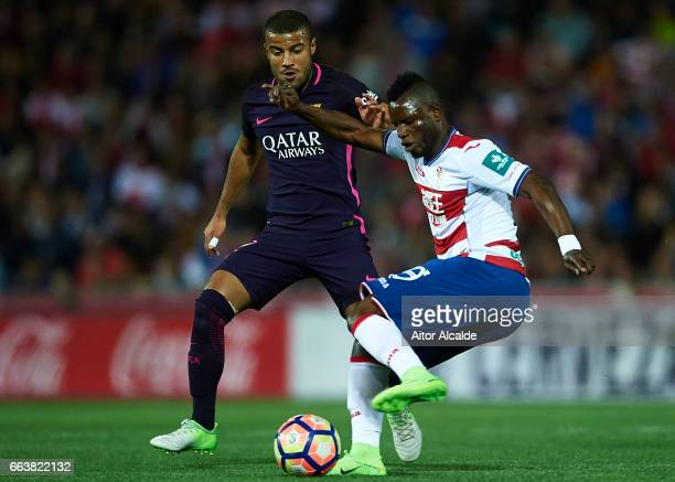 Uche Henry Agbo of Granada CF being followed by Rafinha Alcantara of FC Barcelona during the La Liga match between Granada CF v FC Barcelona at...