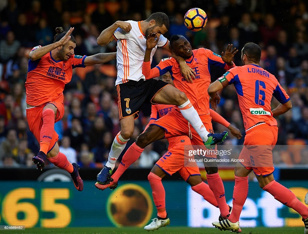Uche Henry-Agbo of Granada competes for the ball with Mario Suarez (7) of Valencia during the La Liga match between Valencia CF and Granada CF at Mestalla Stadium on November 20, 2016 in Valencia, Spain.