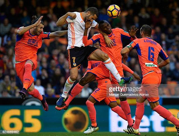 Uche Henry-Agbo of Granada competes for the ball with Mario Suarez of Valencia during the La Liga match between Valencia CF and Granada CF at...