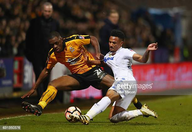 Uche Ikpeazu of Cambridge United battles with Tyler Denton of Leeds United during the Emirates FA Cup Third Round match between Cambridge United and...