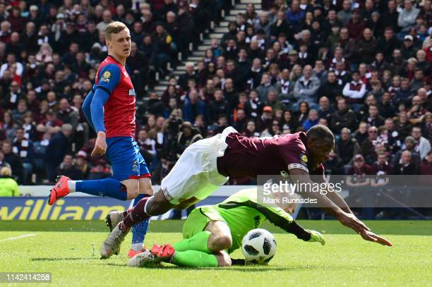 Uche Ikpeazu of of Heart of Midlothian FC is fouled by Mark Ridgers of Inverness Caledonian Thistle and a penalty is awarded during the Scottish Cup...