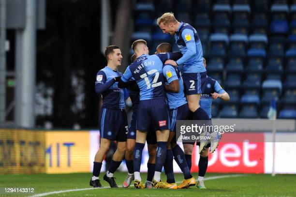 Uche Ikpeazu of Wycombe Wanderers celebrates with teammates after scoring their sides first goal during the Sky Bet Championship match between...