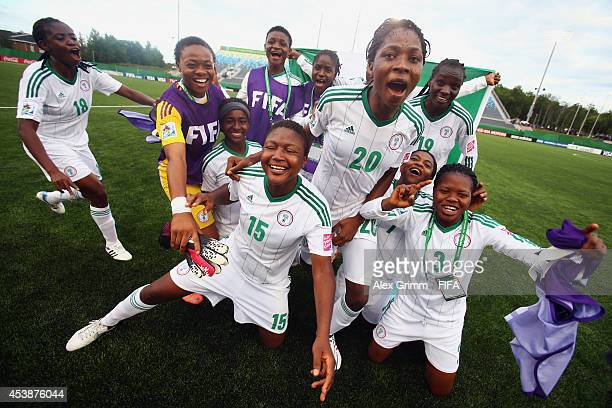 Uchechi Sunday of Nigeria and team mates celebrate after the FIFA U20 Women's World Cup Canada 2014 Semi Final match between Korea DPR and Nigeria at...