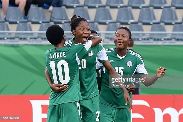 Uchechi Sunday of Nigeria celebrates a goal with teammates Halimatu Ayinde and Ugo Njoku during the FIFA Women's U20 Quarter Final game against New...
