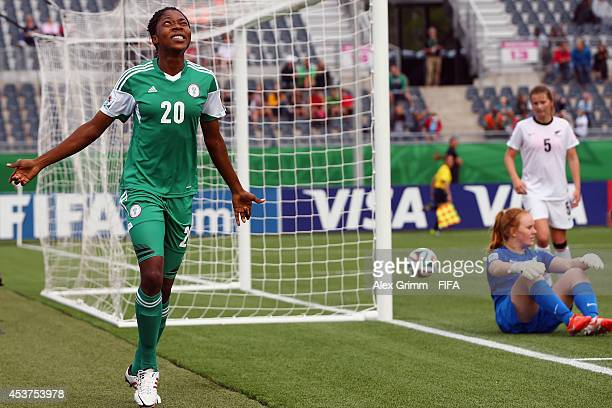 Uchechi Sunday of Nigeria celebrates her team's fourth goal during the FIFA U20 Women's World Cup Canada 2014 Quarter Final match between Nigeria and...