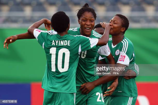 Uchechi Sunday of Nigeria celebrates her team's third goal with team mates during the FIFA U20 Women's World Cup Canada 2014 Quarter Final match...