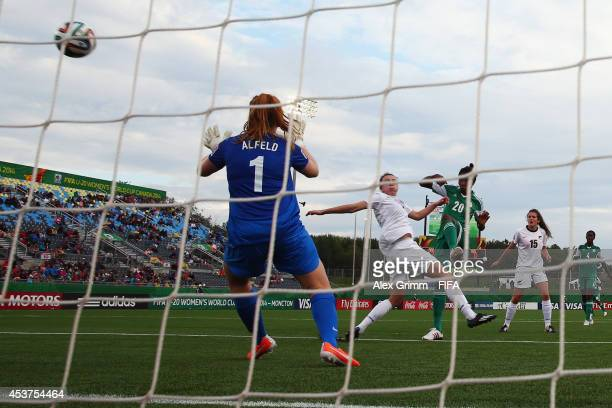 Uchechi Sunday of Nigeria scores her team's third goal against goalkeeper Lily Alfeld of New Zealand during the FIFA U20 Women's World Cup Canada...