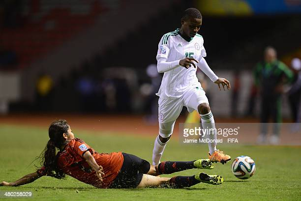 Uchenna Kanu of Nigeria battles with Miriam Garcia of Mexico during the FIFA U17 Women's World Cup Group D match between Nigeria and Mexico at...