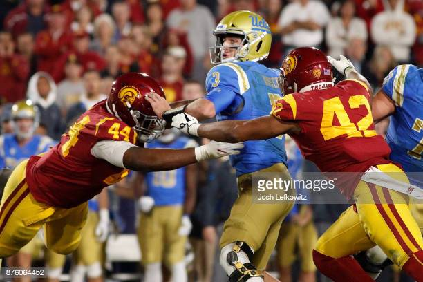 Uchenna Nwosu of the USC Trojans and Malik Dorton of the USC Trojans sack Josh Rosen of the UCLA Bruins at the end of the second quarter during the...