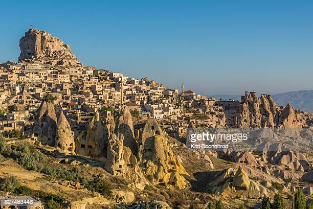 uchisar castle and village from pigeon valley, turkey - カッパドキア ストックフォトと画像