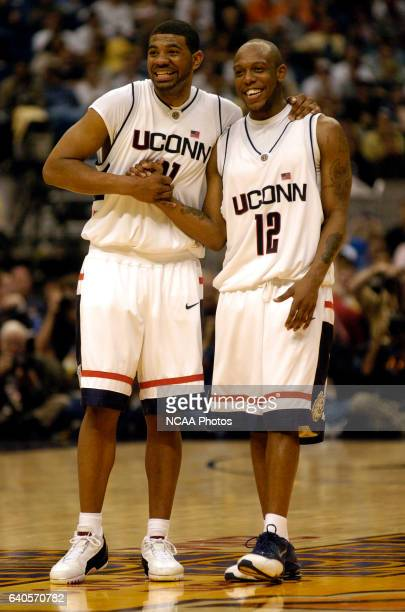 UConn forward Rashad Anderson celebrates with teammate guard Taliek Brown as the final seconds tick off the clock during the Division I Men's...