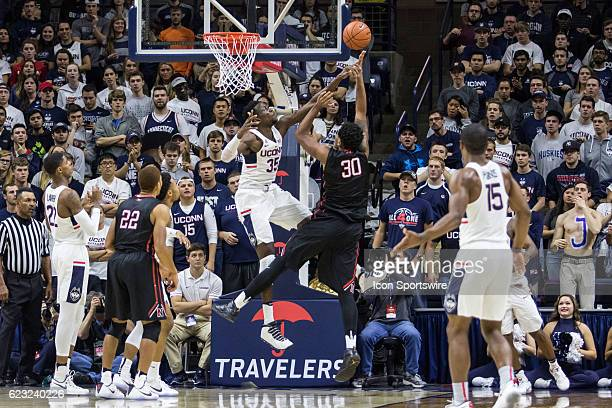 UConn Huskies Center Amida Brimah blocks a shot by Northeastern's Center Anthony Green during the second half of a men's NCAA division 1 basketball...