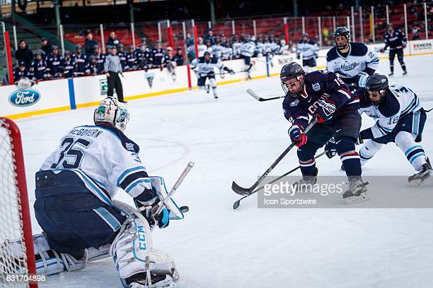 UConn Huskies forward Evan Richardson flicks a shot toward University of Maine Black Bears goaltender Rob McGovern on a breakaway scoring attempt...