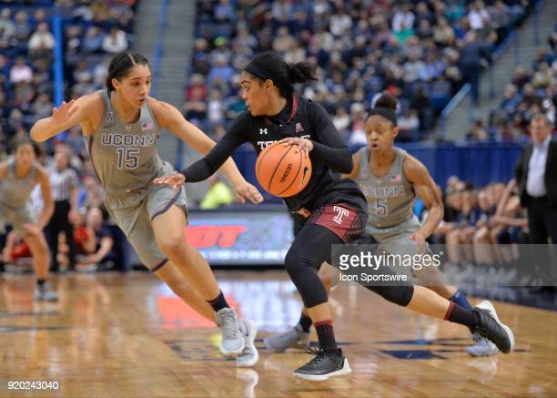 UConn Huskies Forward Gabby Williams and UConn Huskies Guard Crystal Dangerfield attempt to trap Temple Owls Guard Mykia Jones during the game as the...