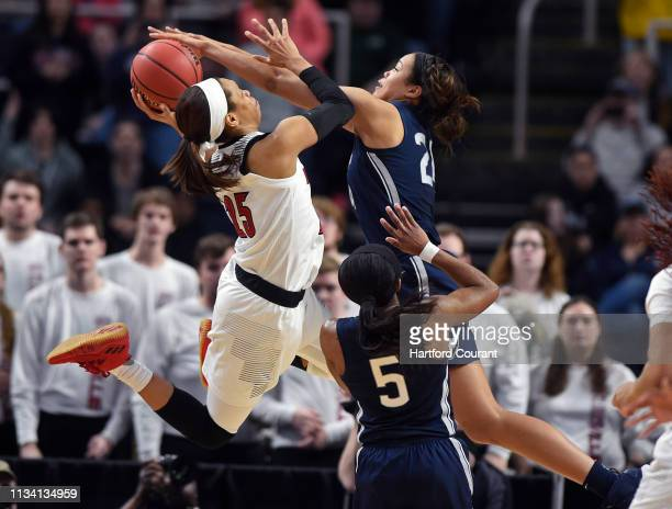 UConn Huskies forward Napheesa Collier defends Louisville Cardinals guard Asia Durr on her way to the basket in the NCAA tournament east regional...