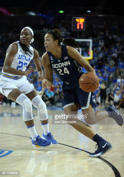 UConn Huskies forward Napheesa Collier dribbles past UCLA Bruins guard Kennedy Burke during the game on November 21 at Pauley Pavilion in Los Angeles...