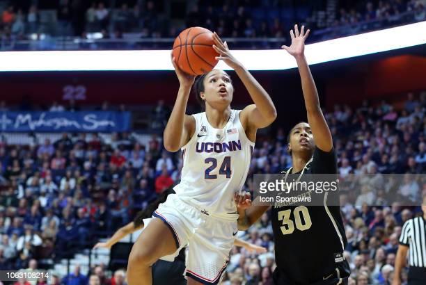 UConn Huskies forward Napheesa Collier shoots over Vanderbilt Commodores guard LeaLea Carter during a women's college basketball game between UConn...