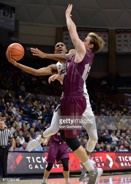 UConn Huskies Forward Tyler Polley is fouled during his shot attempt by Colgate Raiders Center Dana Batt during the game as the UConn Huskies host...