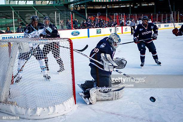 UConn Huskies goaltender Adam Huska blocks a shot during the first period of the game between the University of Maine Black Bears and the UConn...