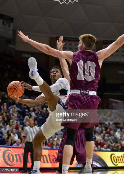 UConn Huskies Guard Alterique Gilbert shoots after being fouled by the Colgate Raiders defender during the game as the UConn Huskies host the Colgate...
