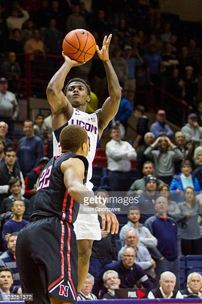UConn Huskies Guard Alterique Gilbert shoots from three point range over Northeastern's Guard Donnell Gresham Jr in the final seconds of the second...