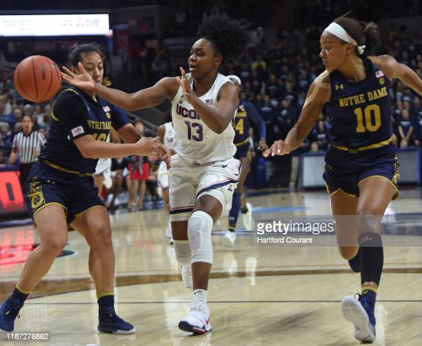 UConn Huskies guard Christyn Williams loses the ball between Notre Dame Fighting Irish guard Marta Sniezek , left, and Notre Dame Fighting Irish...