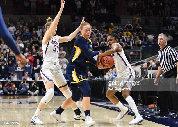 UConn Huskies Guard Crystal Dangerfield forces a turnover from Quinnipiac Bobcats Forward Jen Fay during the game as the Quinnipiac Bobcats take on...