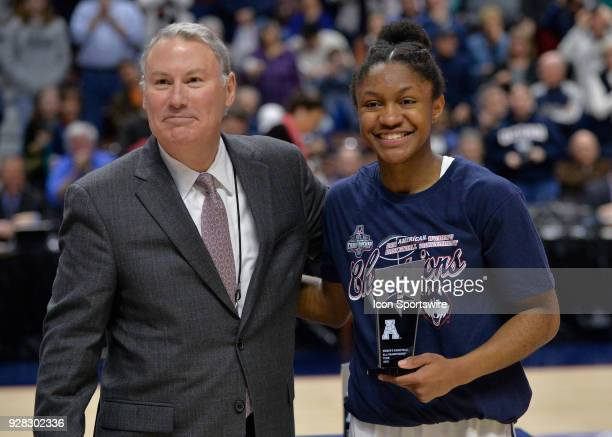UConn Huskies Guard Crystal Dangerfield receives the American Athletic Conference All Championship Team trophy after the game as the South Florida...