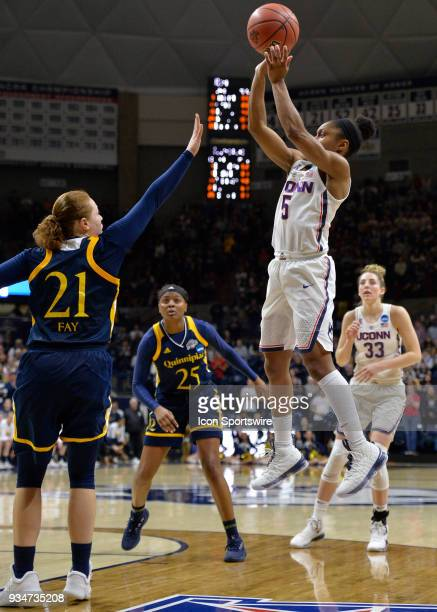UConn Huskies Guard Crystal Dangerfield shoots over Quinnipiac Bobcats Forward Jen Fay during the game as the Quinnipiac Bobcats take on the UConn...